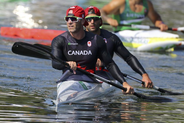 Ryan Cochrane et Hugues Fournel... (Photo Murad Sezer, Reuters)