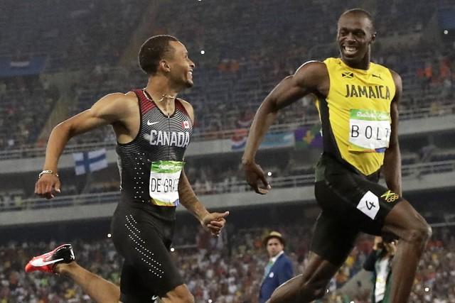 Le Canadien Andre De Grasse et le Jamaïcain... (Photo Matt Dunham, AP)