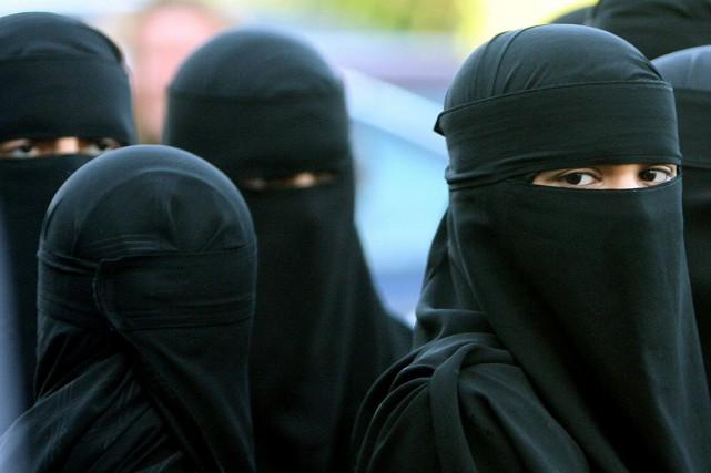 «Interdire la burqa par exemple aura des conséquences,... (Archives AP)
