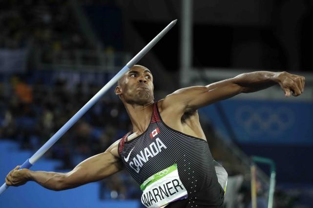 Damian Warner a remporté la médaille de bronze... (AP, Matt Dunham)