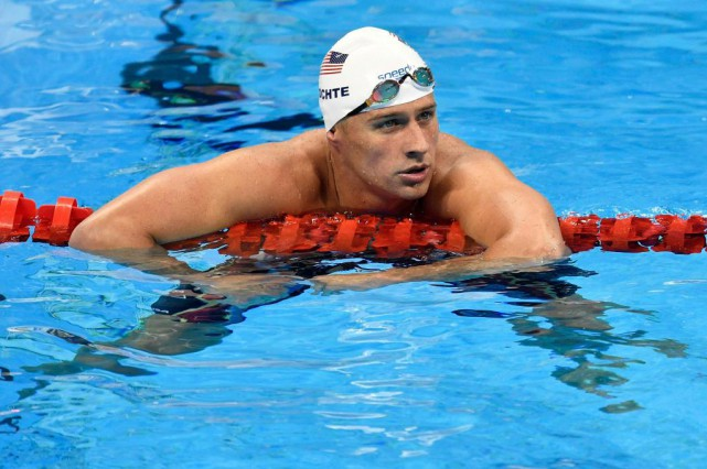 Le nageur américain Ryan Lochte est au coeur... (PHOTO MARTIN MEISSNER, ASSOCIATED PRESS)