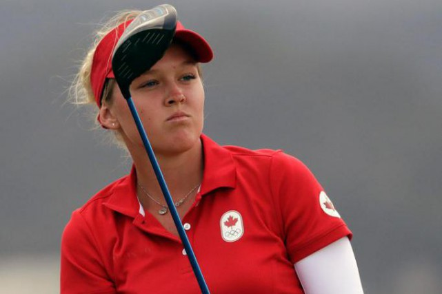 Brooke Henderson s'est hissée au troisième rang du classement,... (photo Alastair Grant, associated press)