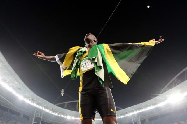 Usain Bolt célèbre son ultime exploit aux JO.... (AP)