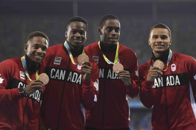 Akeem Haynes, Aaron Brown, Brendon Rodney et Andre... (AFP, Eric Feferberg)