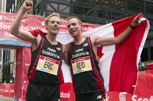 Eric Gillis et Reid Coolsaet... (PHOTO FRANK GUNN, ARCHIVES LA PRESSE CANADIENNE)