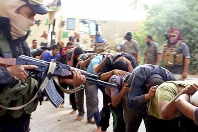 Une image publiée par l'État islamique (EI) en... (Archives AP)