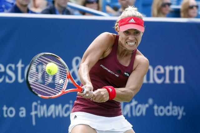Angela Kerber (photo) avait la chance de grimper... (AP, John Minchillo)