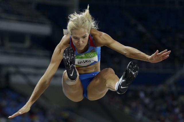 La sauteuse en longueur Darya Klishina a été... (AP, Matt Slocum)
