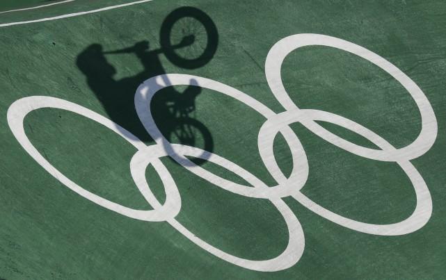 Quand se tiennent les Jeux olympiques, j'aimerais habiter un pays qui n'envoie... (AP, Pavel Golovkin)