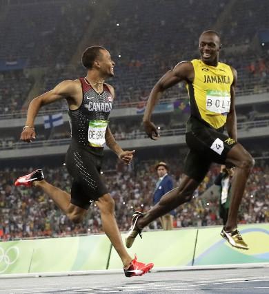 Cette image des hommes les plus rapides au... (The Associated Press)