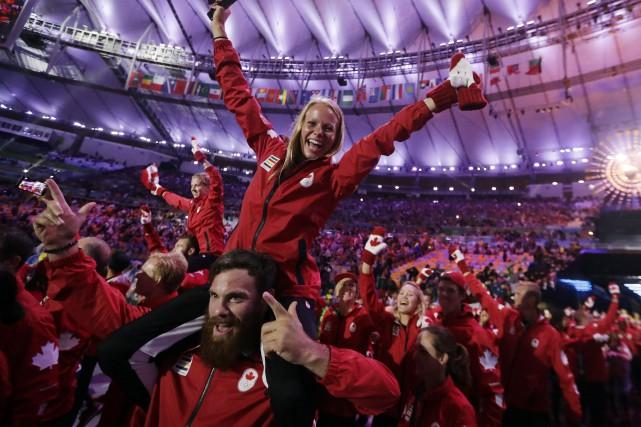 Les athlètes canadiens étaient visiblement heureux de prendre... (Photo David Goldman, AP)