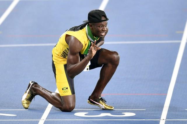 Rapide, électrisant et charismatique, Usain Bolt a marqué... (AP, Martin Meissner)
