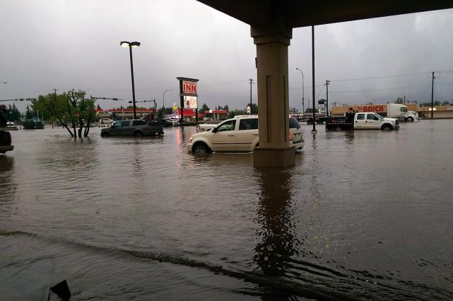 Plusieurs résidences et établissements commerciaux ont été inondés... (PHOTO Adrienne Rimmer, PC)
