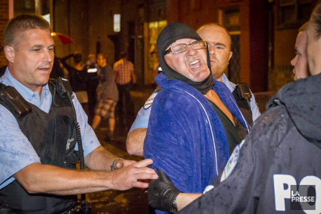 Richard Henry Bain au moment de son arrestation,... (PHOTO OLIVIER PONTBRIAND, LA PRESSE)