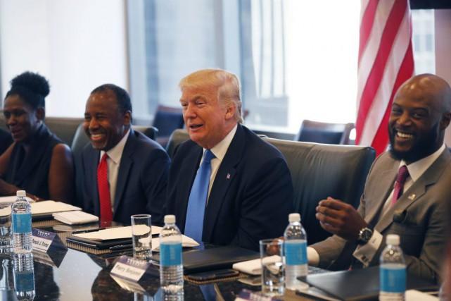 Donald Trump tente notamment d'élargir sa base électorale... (Photo Gerald Herbert, AP)