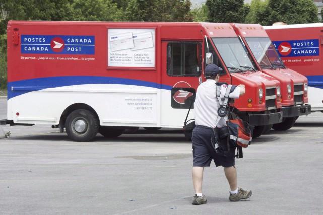 Le Syndicat des travailleurs et travailleuses des postesa... (Archives La Presse Canadienne, Ryan Remiorz)