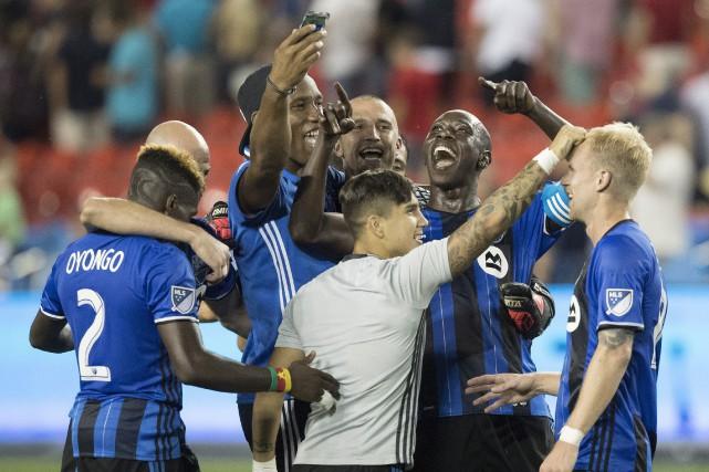 Les joueurs montréalais jubilaient après leur victoire.... (La Presse Canadienne)