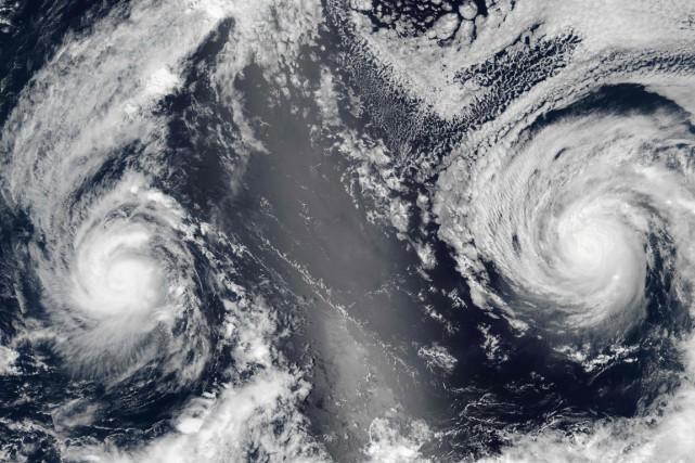 Les ouragans Lester (à droite) etMadeline.... (Photo AFP)