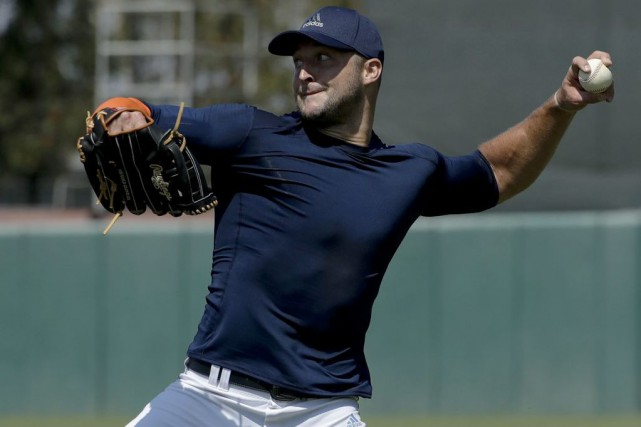 Tim Tebow... (PHOTO Chris Carlson, AP)