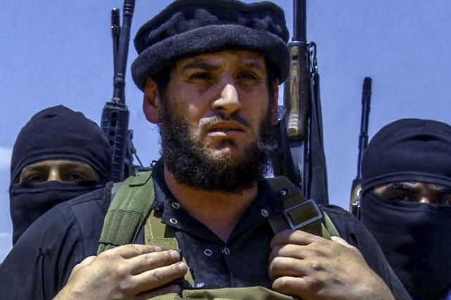 Abou Mohammed al-Adnani... (Photo prise par des militants de l'État islamique, via AP)