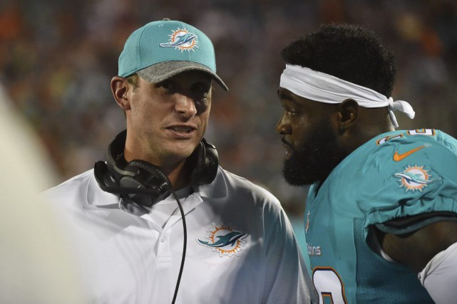 Adam Gase et Reshad Jones... (Photo Jasen Vinlove, archives USA Today Sports)