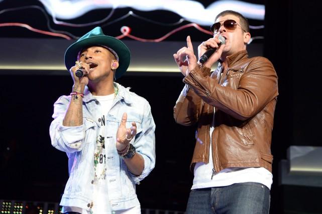 Pharrell Williams et Robin Thicke ont été condamnés... (Archives AFP)