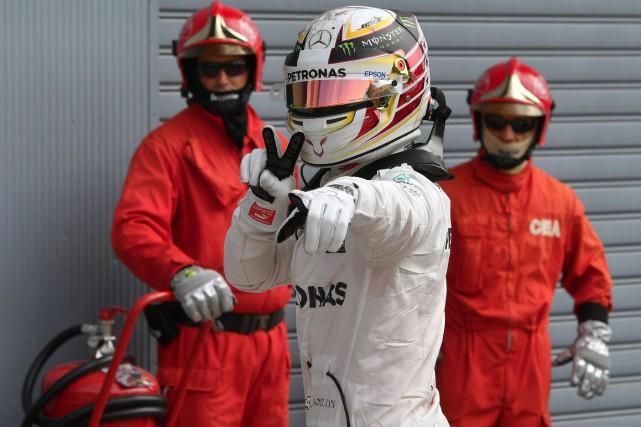 Lewis Hamilton... (AFP, Andrej ISAKOVIC)
