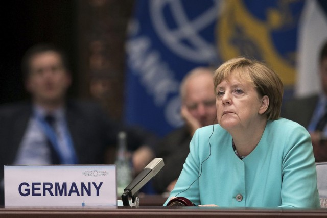 Angela Merkel... (PHOTO Nicolas Asfonri, archives REUTERS)