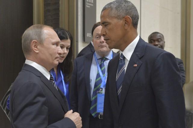 La rencontre entre les présidents russe Vladimir Poutine... (AP, Alexei Druzhinin/Sputnik)