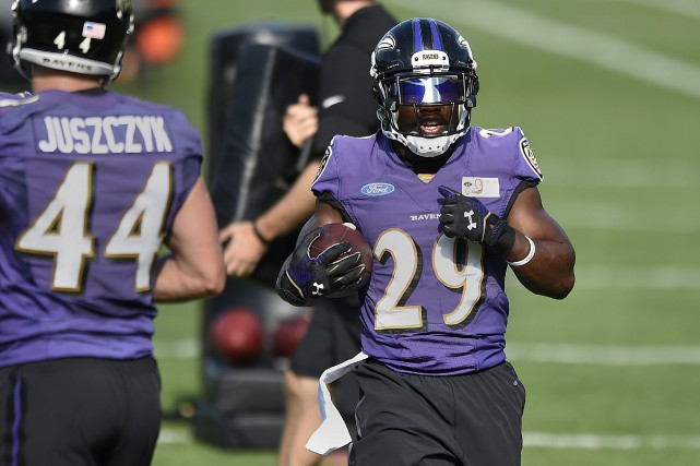 Justin Forsett... (PHOTO Gail Burton, AP)