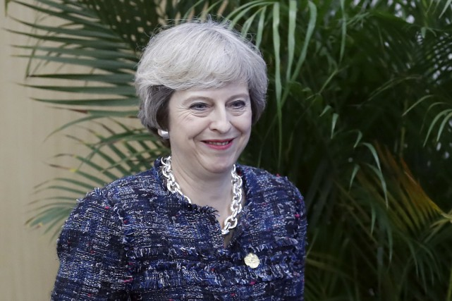 La première ministre conservatrice Theresa May a tenté... (AP, Ng Han Guan)