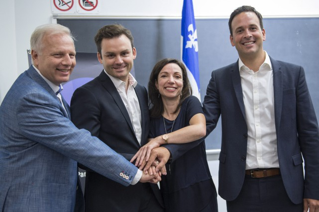 Jean-Francois Lisée, Paul St-Pierre Plamondon, Martine Ouellet et... (Photo Paul Chiasson, La Presse Canadienne)