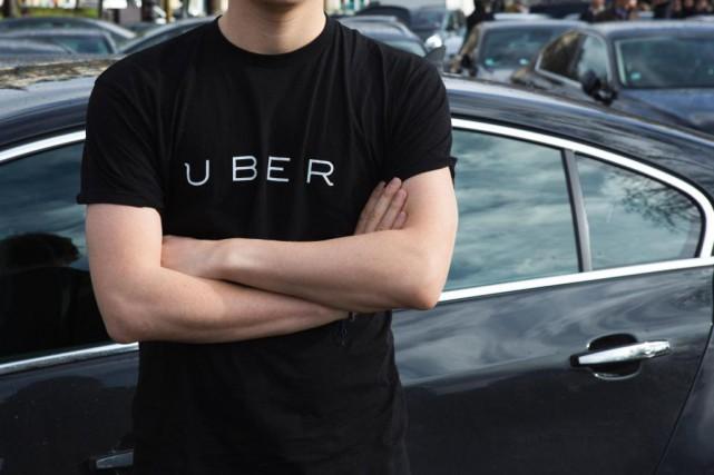 La multinationale Uber a prévenu qu'elle allait suspendreses... (PHOTO AFP)