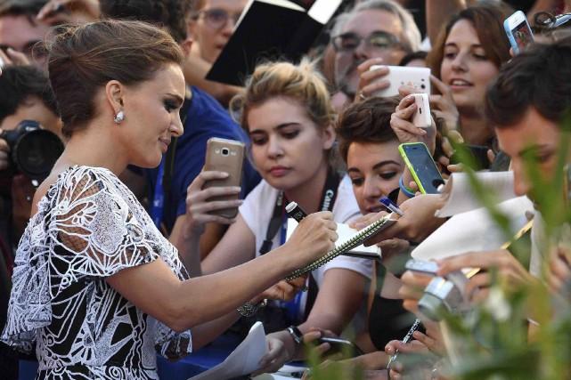 Natalie Portman a fait courir les foules à... (AP, Ettore Ferrari)