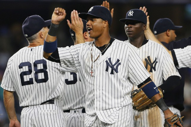Les Yankees se sont approchés à deux matchs... (Photo Noah K. Murray, USA TODAY)