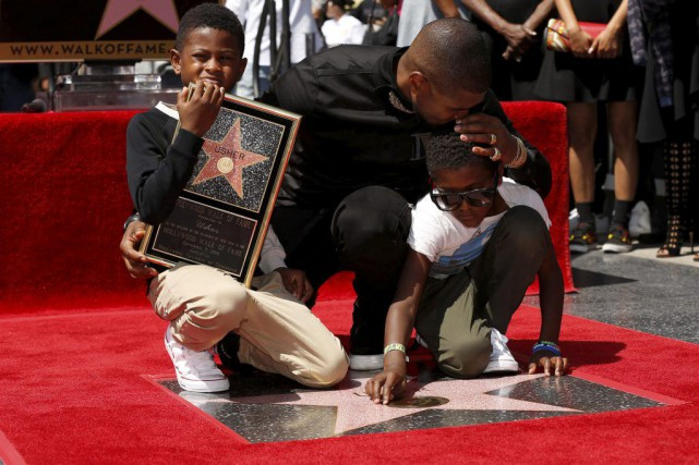 Usher en compagnie de ses fils Usher Terry... (PHOTO REUTERS)