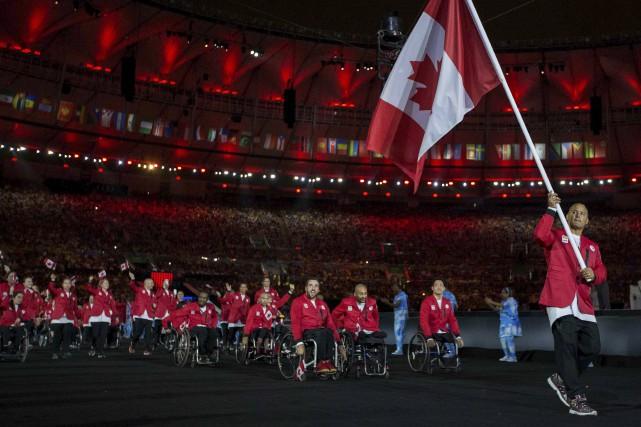 La délégation du Canada faisant son entrée dans... (Agence France-Presse)