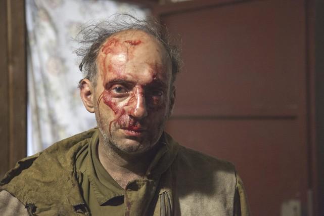 Employé russe de Greenpeace, Michael Kreindin, le visage... (photo Maria Vasileva, greenpeace/AP)