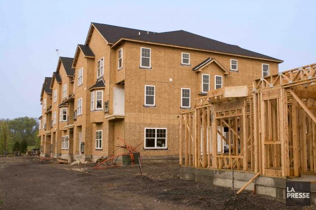 Le marché de la construction résidentielle connaît une baisse importante dans... (123RF/J.R. Bale)
