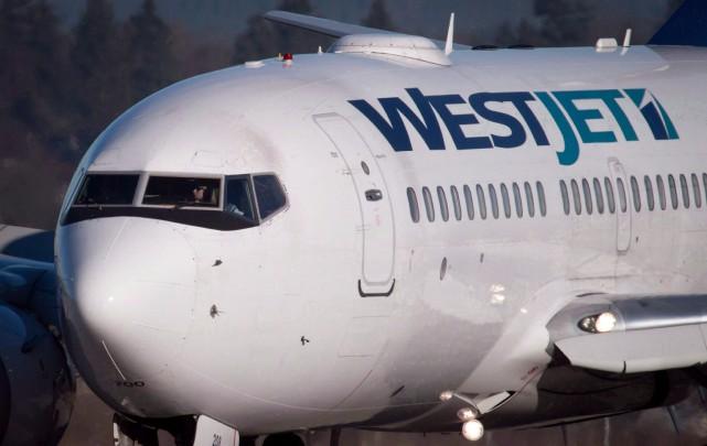 Le transporteur aérien a indiqué sur Twitter que... (PHOTO DARRYL DYCK, ARCHIVES PC)