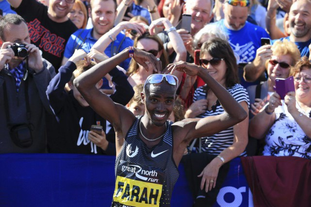 Mo Farah... (PHOTO LINDSEY PARNABY, AFP)