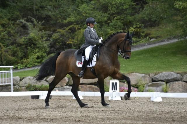 La cavalière québécoise Evi Strasser et son cheval... (Tom Von Kapherr)
