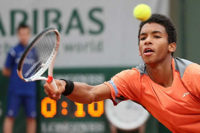 Félix Auger-Aliassime entamera sa carrière professionnelle auréolé du... (Photo David Vincent, archives Associated Press)