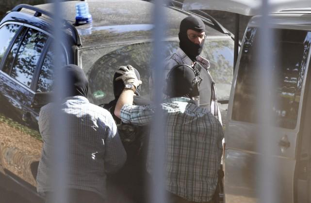 Un homme soupçonné de faire partie de l'EI... (AFP, Uli Deck)
