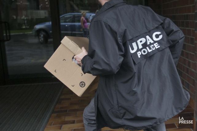 Les enquêteurs de l'Unité permanente anticorruption (UPAC) ont fait irruption à... (Archives La Presse)