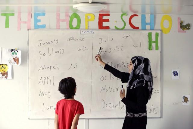 Israa Al Sabsabi, une jeune réfugiée syrienne de... (photo Thanassis Stavrakis, archives AP)