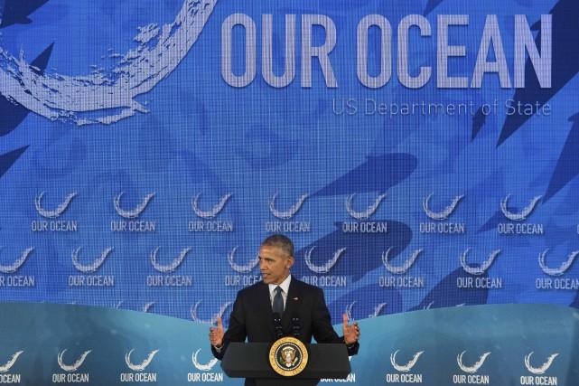 Dans un décor maritime, le président Barack Obama... (AFP, Jim Watson)