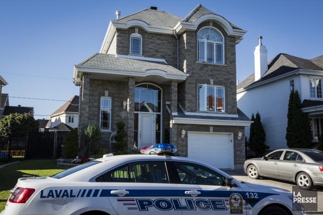 L'une des résidences perquisitionnées à Laval est celle... (PHOTO EDOUARD PLANTE-FRÉCHETTE, LA PRESSE)