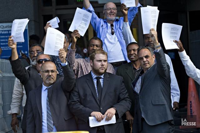 À sa sortie de la salle d'audience, l'avocat... (PHOTO PATRICK SANFAÇON, LA PRESSE)