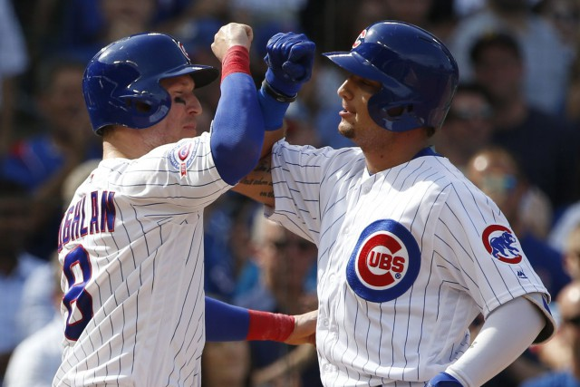 David Ross se dirigeait vers la maison quand les Cubs de Chicago ont remporté... (Photo AP)